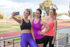 Three females taking a selfie with a mobile phone Royalty Free Stock Photos