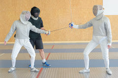Three fencers on practice. Three fencers on a practice Stock Images