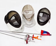 Three fencings and armors Stock Images