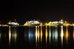 Three ferries at night royalty free stock photos