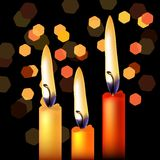 Three festive candles Stock Photography