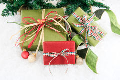 Three festive wrapped gifts Stock Photo