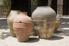 Three fictile old jugs on the sand. Three fictile old ancient jugs on the sand Royalty Free Stock Photography
