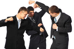 Three fighting businessmen. On white background Royalty Free Stock Images