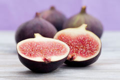 Three figs and a half. Lying on a table stock photos
