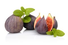Three figs with mint,split like flower isolated on white backgro Royalty Free Stock Image