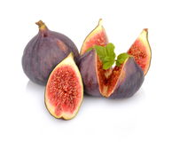 Three figs with mint,split like flower  on white backgro Stock Images