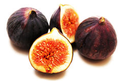 Three figs, one is cut, ripe pulp Stock Image