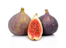 Three figs with quarter  on white background. Two whole figs with quarter  on white background Royalty Free Stock Images