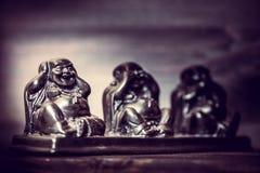 Three figures of Buddah philosophy Stock Image