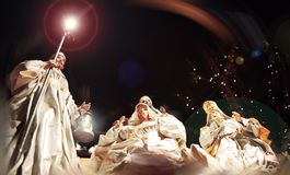 Figurines of the three wise men and the virgin. Three figurines of the three wise men and the virgin on a black background in the light of a star Royalty Free Stock Photography