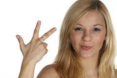 Three with finger. Young blond woman hold 3 fingers up Stock Photo