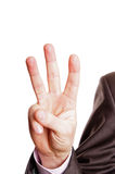 Three finger sign. A suited man holding a three finger sign on white background Royalty Free Stock Photos