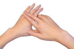 Three fingers of right female hand are lying on left hand Royalty Free Stock Photos