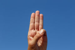 Three fingers with sky background Stock Image