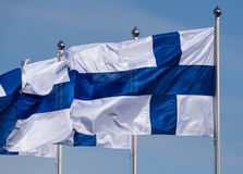 Free Three Finnish Flags Flying Royalty Free Stock Photo - 92424635