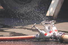 Three fire hoses. With drippling water Royalty Free Stock Photos