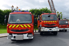 Three fire trucks parked Stock Photos