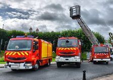 Three fire trucks parked Royalty Free Stock Photos