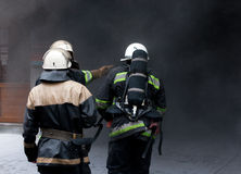 Three Firefighters, going in a fire. Stock Images