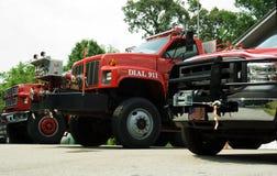 Three Firetrucks Ready to Roll. Three firetrucks ready in case of an emergency royalty free stock photo
