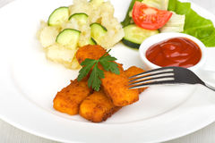 Three fish fingers Stock Images