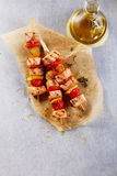 Three Fish Kebabs on Table with Bottle of Oil Royalty Free Stock Photography