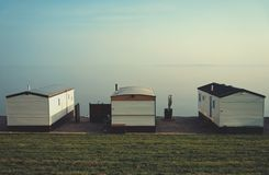 Three fisherman huts stock photo