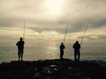 Three fisherman Royalty Free Stock Photo