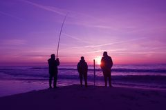 Three fishermen Stock Images