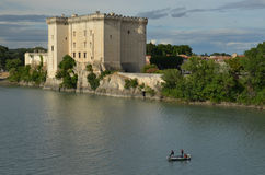 Three fishermen on river Rhone under castle Tarascon Royalty Free Stock Images