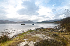 Three fishing boats on a Scottish Loch. Three fishing boats on a Scottish lake Royalty Free Stock Image