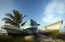 Three fishing boats on shore caribbean sea Stock Photos