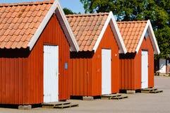 Three fishing cabins Royalty Free Stock Photos