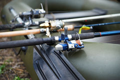 Three fishing spinning in a rubber boat Royalty Free Stock Photo