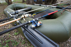 Three fishing spinning in a rubber boat Stock Image