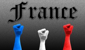 Three fists in the air with the colors of France flag stock photo