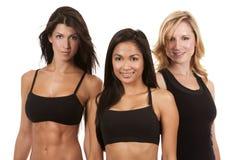 Three fitness women. Beautiful three women wearing fitness on white background Stock Photos