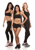 Three fitness women. Beautiful three women wearing fitness on white background royalty free stock image