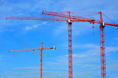 Three Fixed Construction Sky Cranes Stock Image
