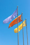 Three flags against blue sky. Royalty Free Stock Photography