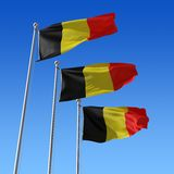 Three flags of Belgium against blue sky. 3d illust Royalty Free Stock Images