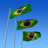 Three flags of Brazil against blue sky. 3d illustr Stock Photo