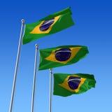 Three flags of Brazil against blue sky. 3d illustr Stock Photo