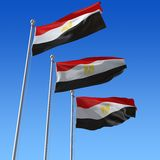 Three flags of Egypt against blue sky. Stock Photo