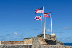 Three flags of El Morro, Puerto Rico. Flags in El Morro fortress , Puerto Rico Royalty Free Stock Image