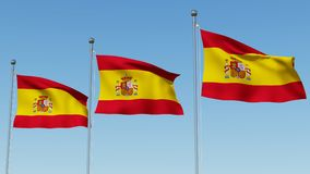 Three flags of Spain against blue sky. Royalty Free Stock Images