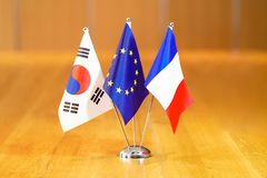 Flags of South Korea, European Union and France. Three flags on the table. Flags of South Korea, European Union and France. Flags of South Korea, European Union stock images