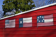Three flags of Texas painted on metal wall. Metal garage in Austin, Texas painted with three of the six flags of Texas Royalty Free Stock Image