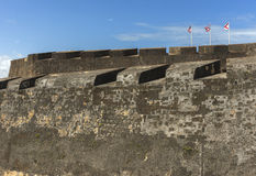 Three flags on top of Castillo San Christobal. Stock Images